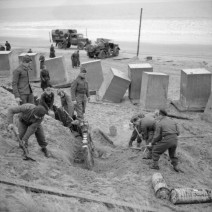 Engineers of the 1st Rifle Brigade constructing anti-tank obstacles at Tentsmuir in Scotland - Imperial War Museum